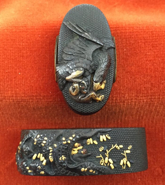 Fuchi-kashira with designs of eagle holding a monkey, and young monkey sheltering under a tree.