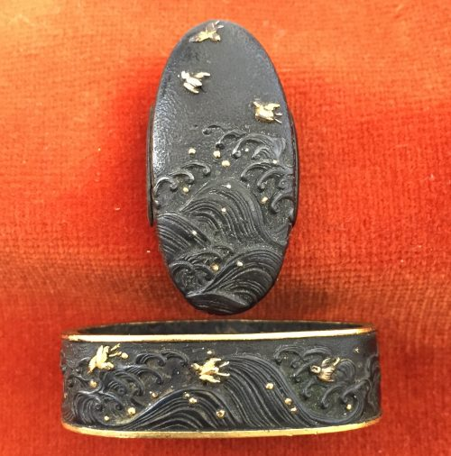 Fuchi-kashira with designs of plovers above the waves