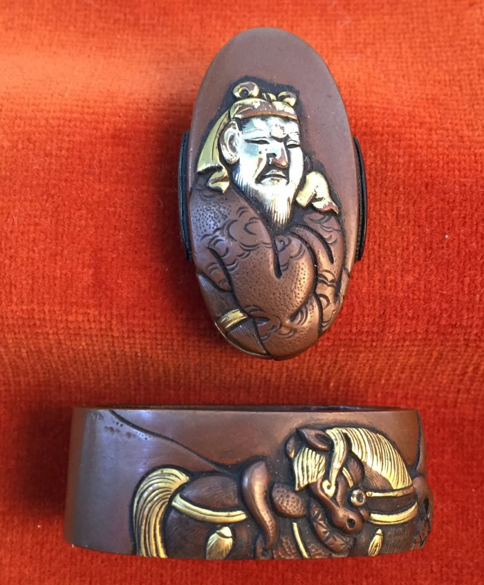 Fuchi-kashira with designs of warrior and horse
