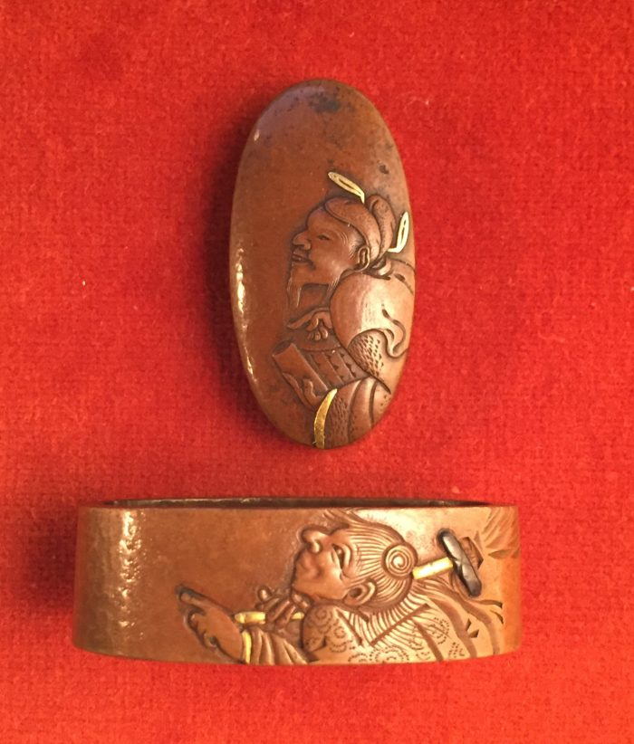Fuchi-kashira with designs of Kanzan and Jittoku by Josui.