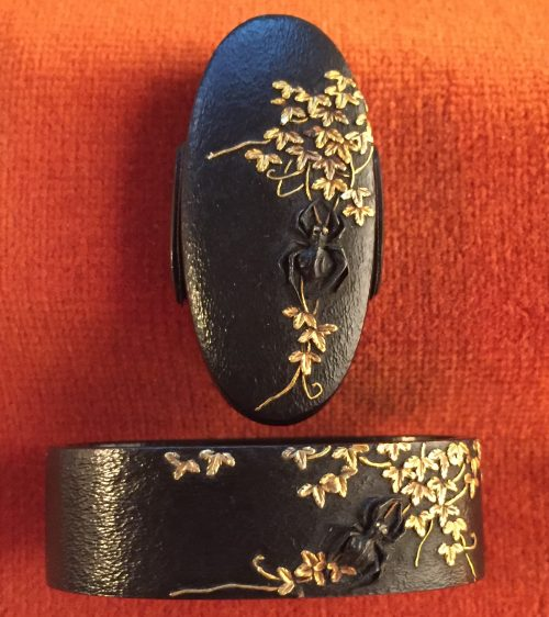 Fuchi-Kashira with designs of vines and spiders